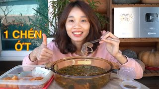 Eating hot and spicy beef cabbage soup - one of the most popular foods in Korea for the cold weather
