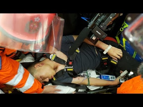Man knocked out by protesters at HK airport