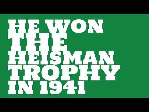 What grade was Minnesota when he won the Heisman Trophy?