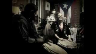 lydia perez plays the drum accompanied by carlos cruz new england artist