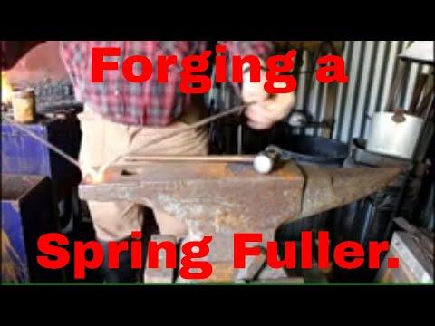 Forging a spring fuller.