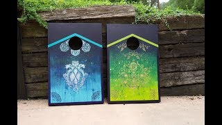 Artist Paints Custom Corn Hole Boards