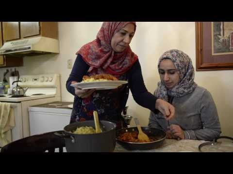 Refugees from Iraq cook