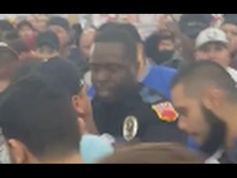 Black Friday Brawl 2015 (El Paso, Texas Walmart): Loco dude swings at black cop