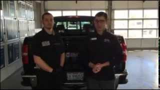 How to remove the spare tire on a GMC Sierra truck - Cable Dahmer GMC