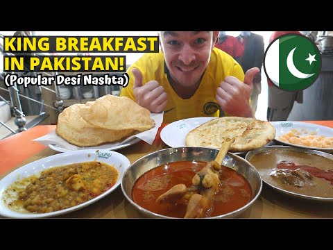 First time trying popular PAKISTANI BREAKFAST (halwa puri, paye, nehari) - PAKISTAN STREET FOOD TOUR