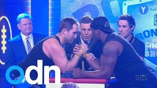 Excruciating arm break in LIVE television arm wrestle