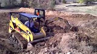 Caterpillar skid steer pond digging