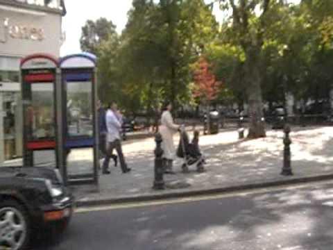 Jason and Jennifer walk through south London's Chelsea district