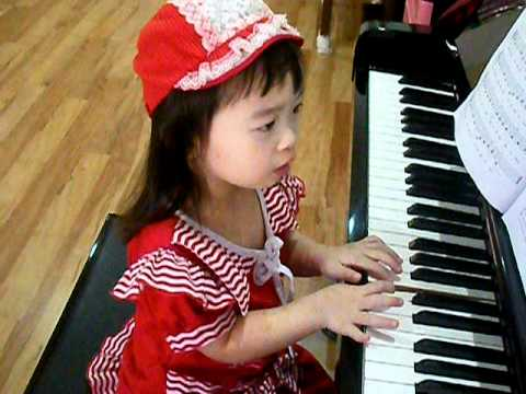 Gifted Baby playing piano