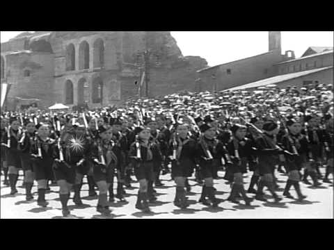 Premier Benito Mussolini and high Fascist officials see parade in Italy, Rome. HD Stock Footage