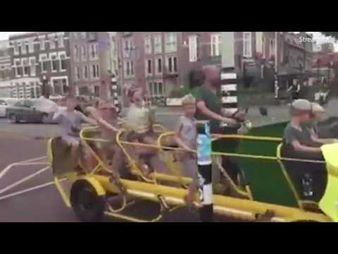 Children wave happily as they cycle on 'bus' to school in Netherlands