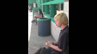 Kid plays harmonica at lunch.