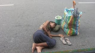 I give some money to a homeless Vietnamese woman