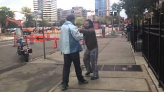 Calgary AB citizen arrest.  Little guy pounds his nuts.  Cops show up quick.