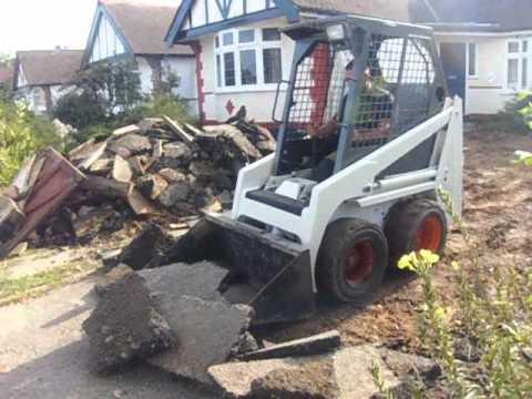 Bobcat 443 removing asphalt and concrete driveway youtube for Removing concrete driveway
