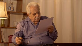 Shot of an Indian old man with eye sight issues finding it difficult to read the document