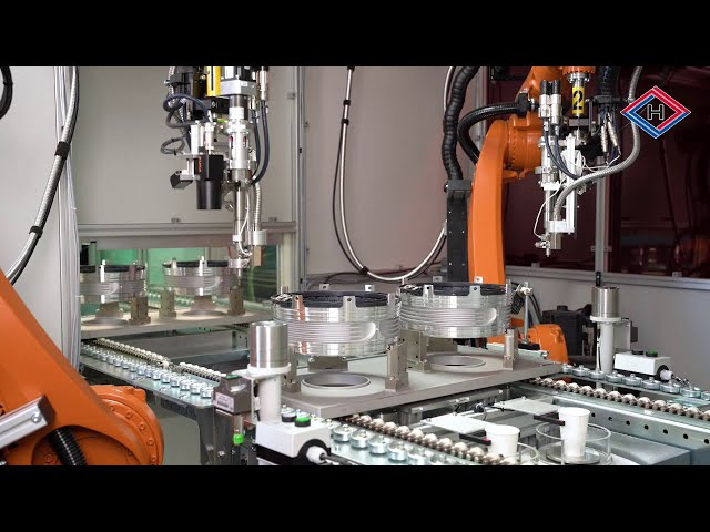 Fully automatic vacuum casting plant for the high volume production of stators for hybrid drives