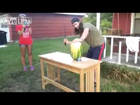 Middle'finger say helllo's VIDEO  Man cuts watermelon with sword = FAIL [ SAD N SCERY ]
