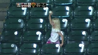 Fan gives souvenir foul ball to young girl