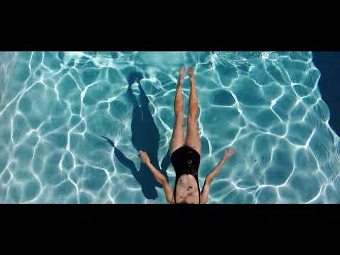 Model diving in a pool with Jewelry for Guilford and Co