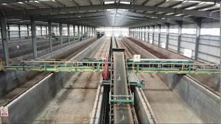 Commercial Scale Composting Facility Setup, Elevating Belt Compost Turner