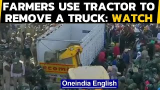 Farmers clashed with forces at Tikri border, removed a truck with a tractor: Watch|Oneindia News