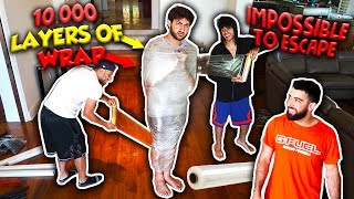 10,000 LAYERS OF SARAN WRAP ESCAPE CHALLENGE!!