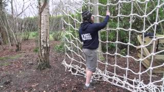 How to climb a vertical cargo net at an obstacle race