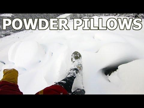 Snowboarding Through Powder Pillows Off Of Whistler Peak