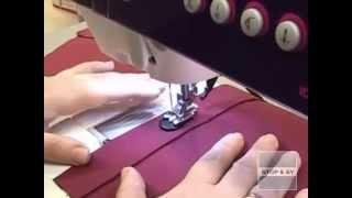 Knap i syning med symaskine