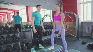 Personal training in the gym: Male fitness trainer and a woman