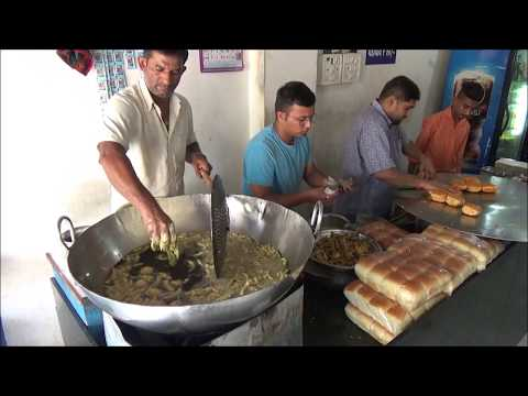 "Freshly made ""Cheese Butter Vada Pav"" Indian Street Food at ""CHOPATI KING VADAPAV"" in Bardoli, India"