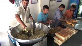 """Freshly made """"Cheese Butter Vada Pav"""" Indian Street Food at """"CHOPATI KING VADAPAV"""" in Bardoli, India"""