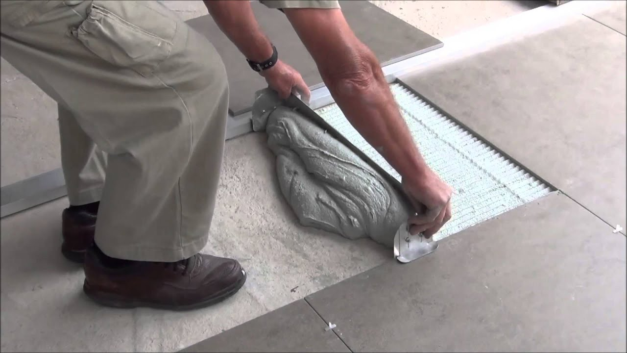 how to lay large format tiles without using a self