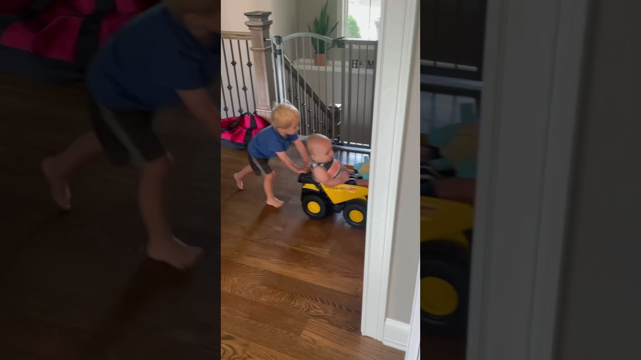 2 Year Old Pushes Baby Brother On Truck!