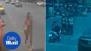 Stark naked woman runs down middle of road in broad daylight - Daily Mail