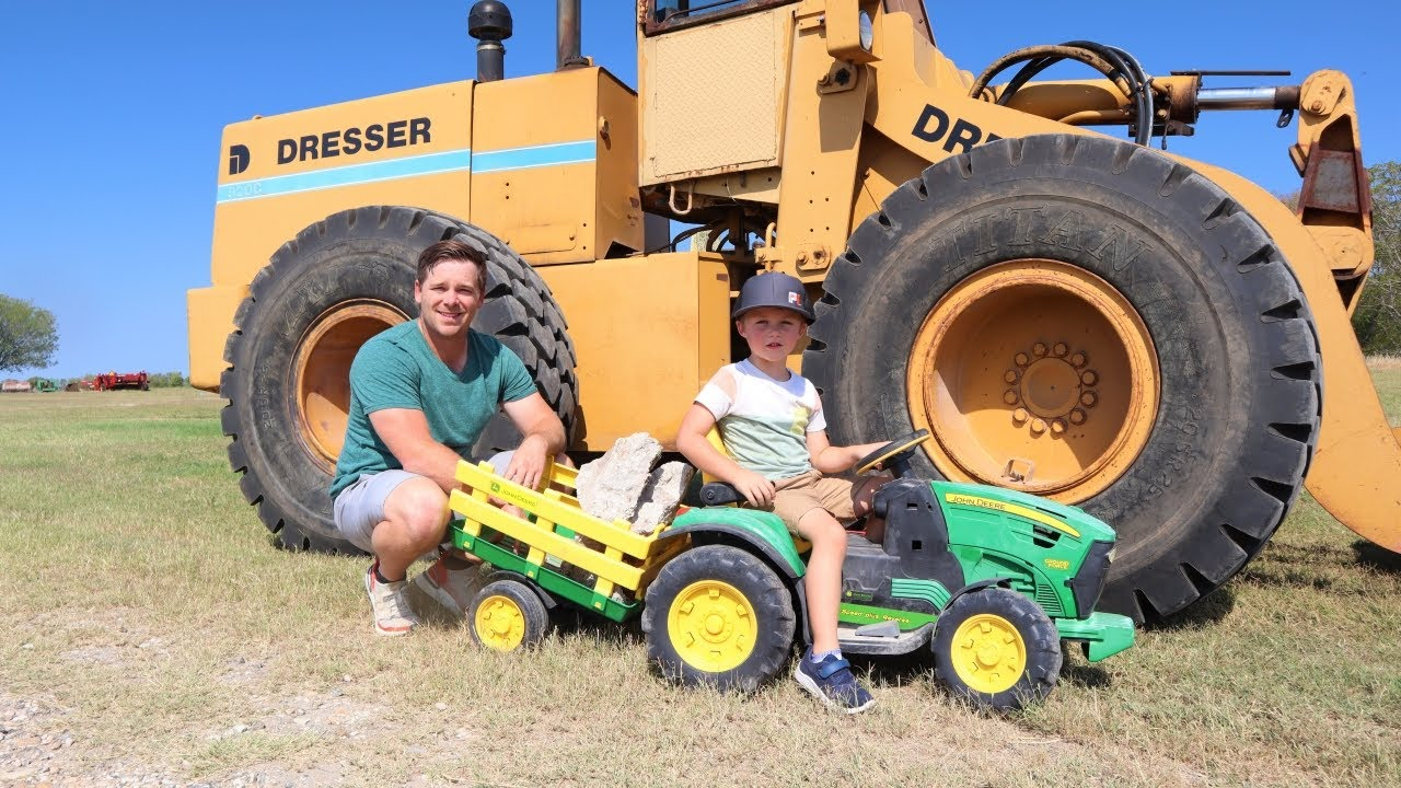 Using real tractors to move rocks on the farm | Tractors for kids | Working on the farm