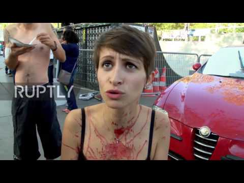 France: Blood-smeared vegans strip off, get BRANDED with hot iron for animal rights