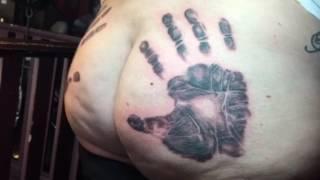 Her husbands handprints tattooed on her ass!