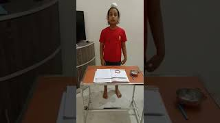 Student of class IV from Uma Devi Children's Academy doing his math's home work by doing activity