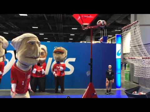 The Racing Presidents spike a volleyball