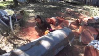 super girl on chainsaw cuttingwood.