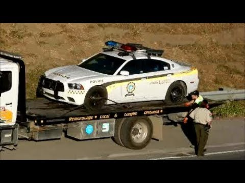 QUEBEC PROVINCIAL POLICE CAR GETS TOWED IN MONTREAL