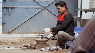 Shot of an Indian worker doing hammer job at a workshop