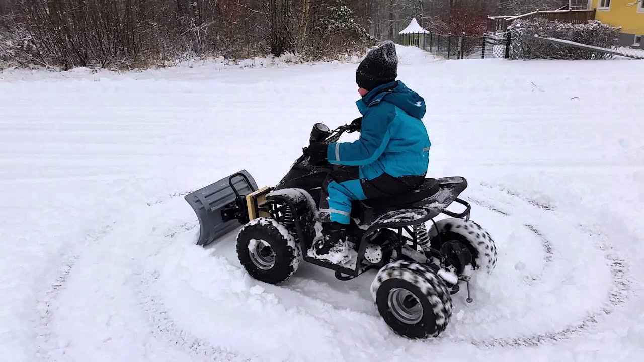 Electric Atv Snow Plowing Youtube