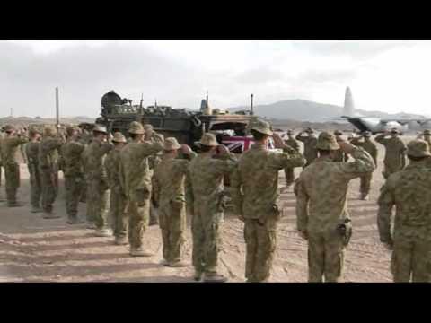 Three fallen Australian soldiers begin journey home