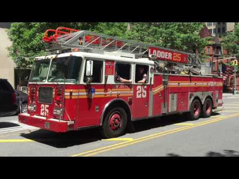 FDNY LADDER 25 RESPONDING URGENTLY WITH AIR HORN ON WEST END AVENUE IN MANHATTAN IN NEW YORK CITY.