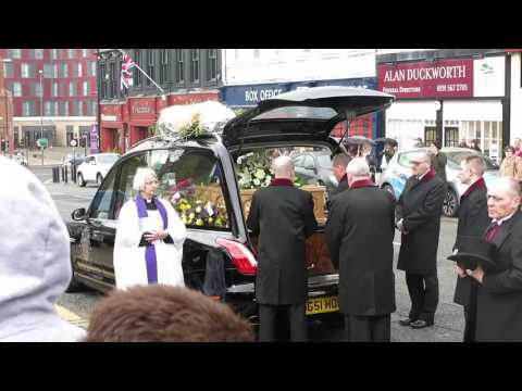 The Coffin of Denise Robertson Being Carried Out Of Her Funeral