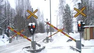 Finnish freight train 3365 passed Eerola level crossing